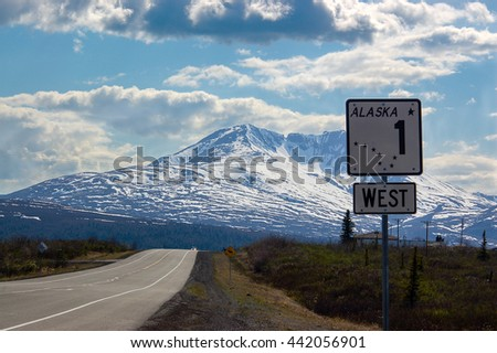 The Alaska road sign number one shows direction to the west on scenic route of Glenn highway.