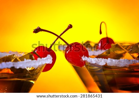 The alcoholic drink with ice and cherries  - stock photo