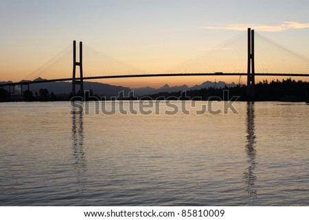 The Alex Fraser Bridge, just before sunrise, spanning the Fraser River at Delta, BC near Vancouver. Canada. - stock photo