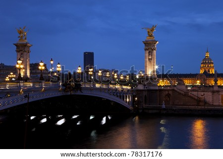 The Alexander III bridge and the Dome of Invalides at night. Paris, France. - stock photo