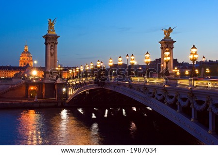 The Alexander III bridge and the dome of the Invalides at night - Paris, France - stock photo