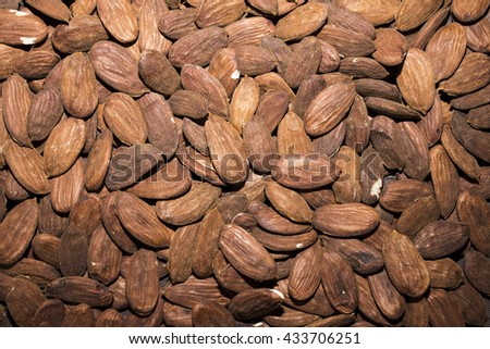 The almond that we think of as a nut is technically the seed of the fruit of the almond tree, a medium-size tree that bears fragrant pink and white flowers. - stock photo