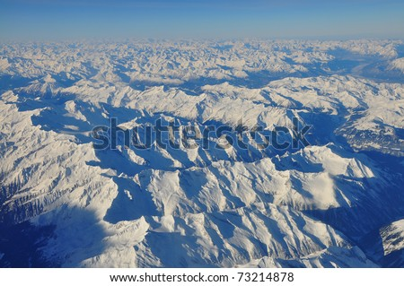 The Alps in winter out of the plane - stock photo