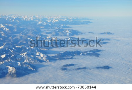 The Alps in winter out of the plane