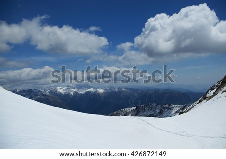 The Alps, view from the top of snowy mountain pass Portula Pass, Bergamo Alps, Lombardy, Italy  - stock photo