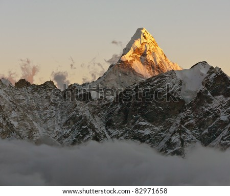 The Ama Dablam peak at sunset - Nepal - stock photo