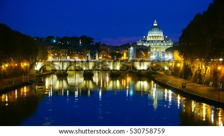 The amazing skyline of Rome by night - River Tiber and Saint Peters - ROME / ITALY, NOVEMBER 6, 2016