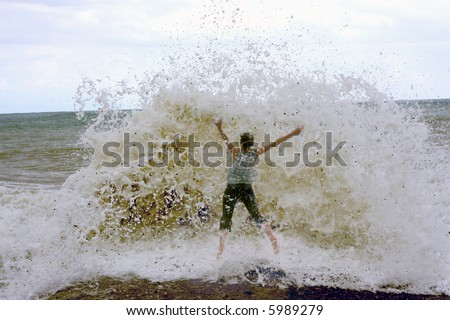 the amazing storm landcscape and jumping girl - stock photo