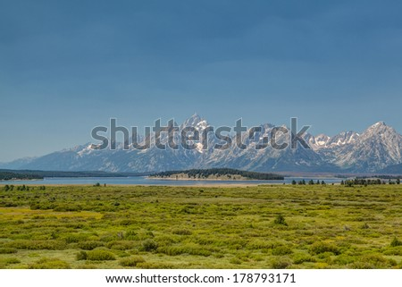The amazing Teton mountains above Jackson Lake in Wyoming, USA. - stock photo
