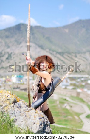 The Amazon pulling the bowstring - stock photo