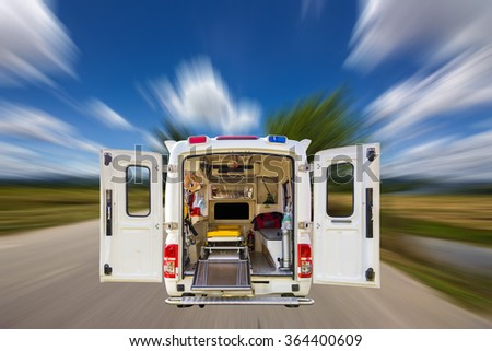 The ambulance, blur image of the road as background. - stock photo