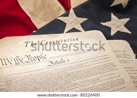 The American Constitution on a flag background (Selective Focus) - stock photo