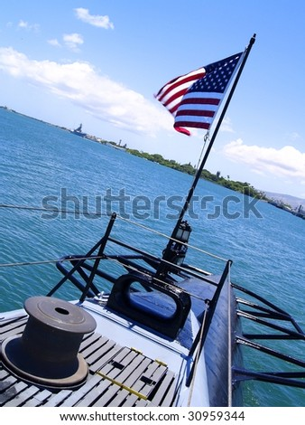 The American flag flies on the U.S.S. Bowfin, a WWII submarine at Pearl Harbor, Hawaii - stock photo