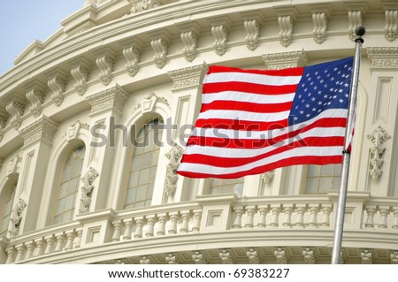 The American flag flies over the US Capitol dome