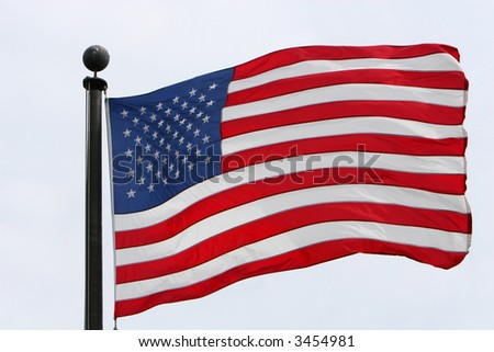 the american flag flying in the wind - stock photo