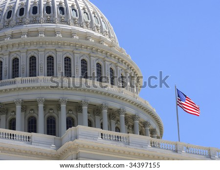 The American flag flying over the United States Capitol.