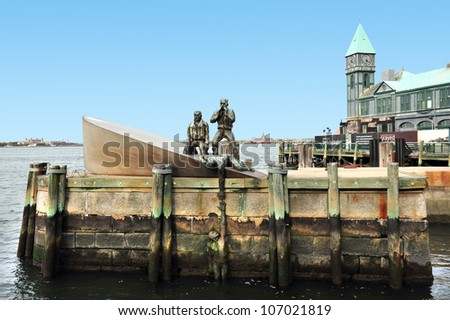 The American Merchant Mariners Memorial sculpture in City pier A in Battery Park in lower Manhattan New York City, New York NYC USA. - stock photo