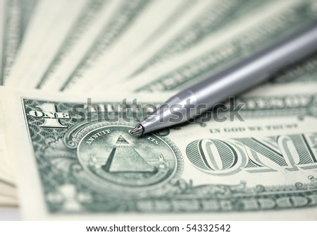 The American money dollars. Bundle of bank notes and pen - stock photo