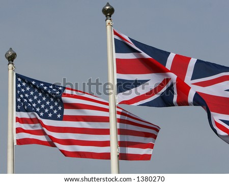 The American Stars and stripes flying from a flagpole next to the Union Jack of Great Britain - stock photo