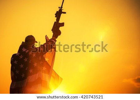 The American Victory. Army Troop with Assault Rifle Covered by American Flag. American Patriot - stock photo