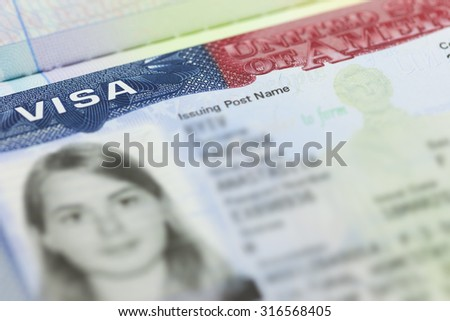 The American Visa in a passport page (USA) background - selective focus - stock photo
