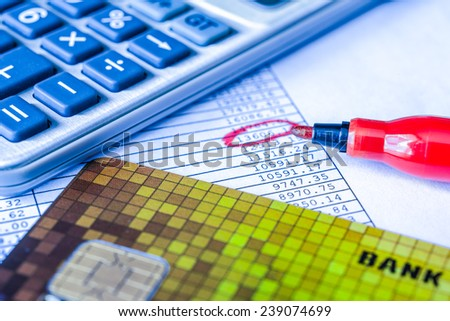 The amount of debt payments, total amount circle with a red marker. In blue tone - stock photo