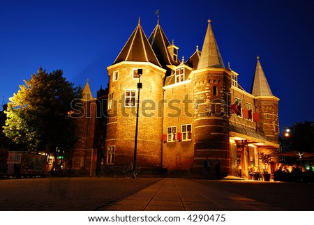 The Amsterdam historical Waag building in Nieuwmarkt square - stock photo
