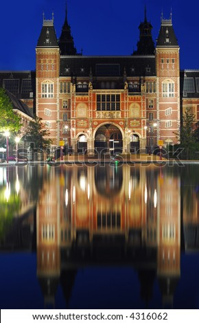 The Amsterdam Reichsmuseum at night - famous art museum - stock photo