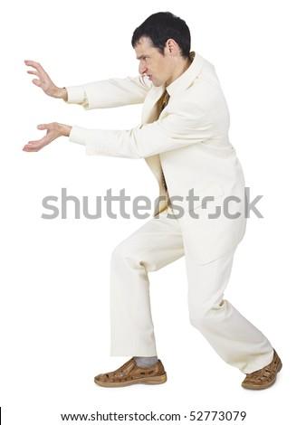 The amusing businessman pushes something forward on white - stock photo