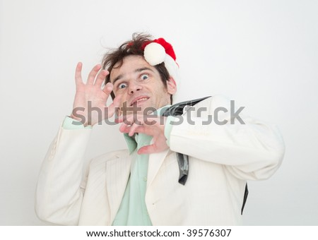 The amusing man in a white suit and christmas cap is frightened - stock photo
