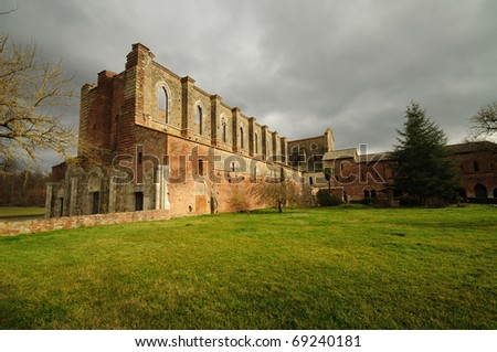 The ancient Abbey of San Galgano  is a mirable example of romanesque architecture in Tuscany (Italy) - stock photo