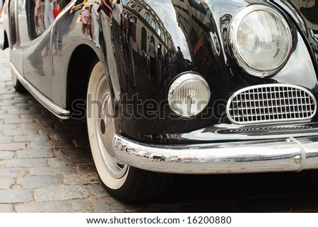 The ancient car in old city - stock photo