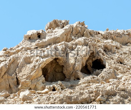 The ancient caves on the shore of the Dead sea - Israel - stock photo