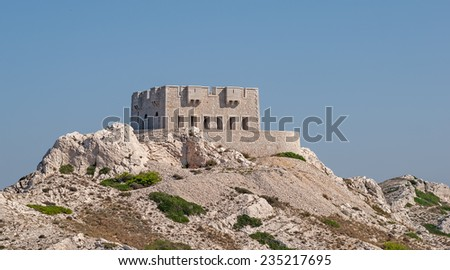"""The ancient defense tower on the island """"Frioul"""" near Marseille in South France - stock photo"""