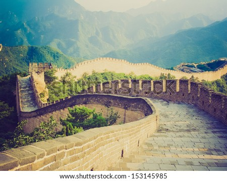 The ancient Great Wall of China fortifications vintage looking - stock photo