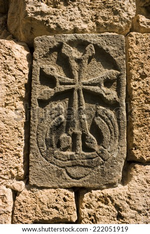 The ancient Khachkar in wall - carved memorial stone, Armenia - stock photo