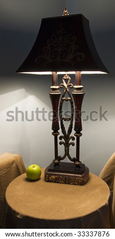 The ancient lamp and green apple - stock photo