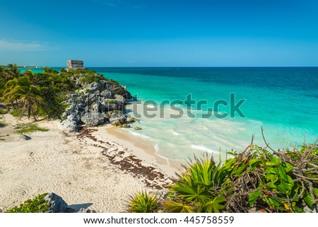 The ancient Mayan ruins of Tulum, Mexico, sit atop the cliffside overlooking the Caribbean sea.