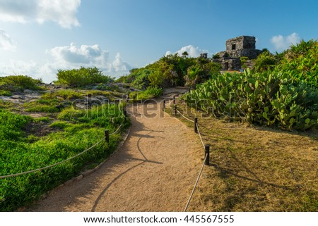 The ancient Mayan ruins of Tulum sit atop the cliffs of Tulum, Mexico, overlooking the Caribbean sea.