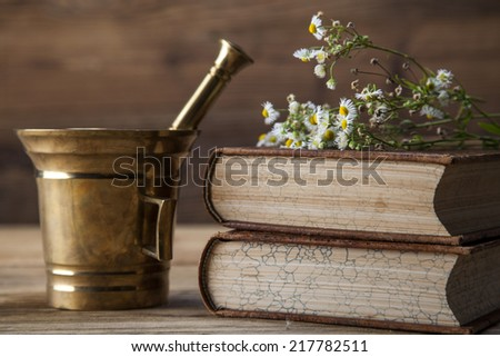The ancient natural medicine, herbs,  medicines and old book - stock photo