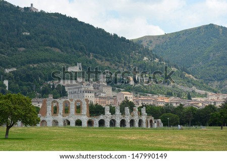 The ancient old city of Gubbio, Umbria province, Italy (Europe) with the old theatre in front. - stock photo