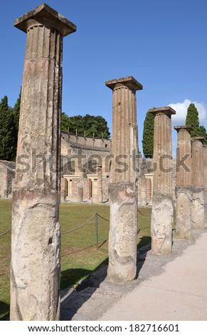 The ancient Roman city of Pompeii. Doric columns in the gladiator barracks. - stock photo