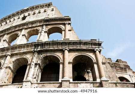 The ancient ruins of Roman coliseum. Italy. - stock photo