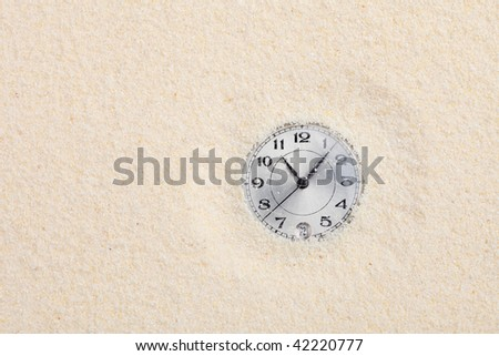 The ancient scratched watch shipped in sand - stock photo