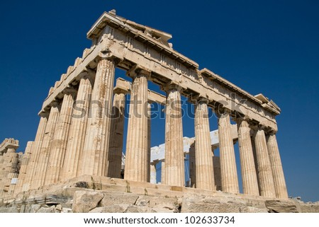 The ancient temple of Parthenon on the Acropolis of Athens, Greece, with deep blue sky behind.