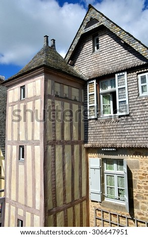 The ancient village of Mont Saint Michel, old traditional colorful houses with its roofs - stock photo