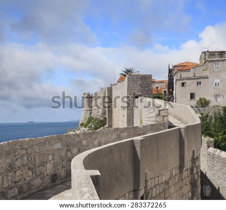 The Ancient Wall Around the Croatian City of Dubrovnik - stock photo