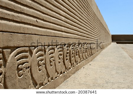 The ancient wall carvings of Chan Chan Ruins in Peru - stock photo