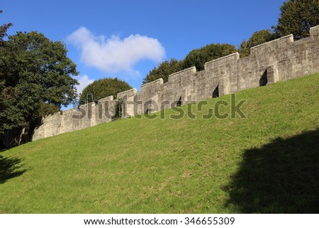 The ancient wall of the city of York, England. - stock photo