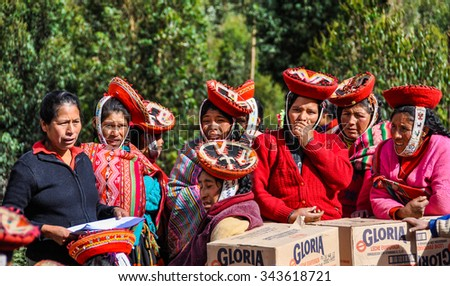 THE ANDES, PERU - MAY 30, 2012: Quechua community receives help in a village in the mountains of The Andes over Ollantaytambo, Peru - stock photo